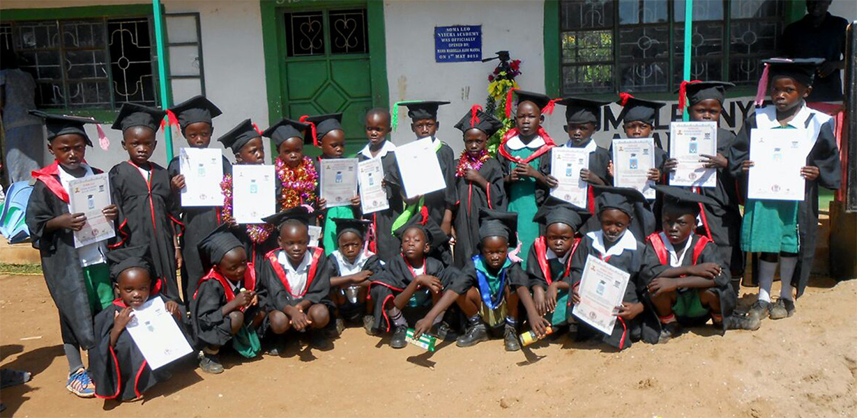 School Children in graduation cap and gown. The Soma Leo Foundation
