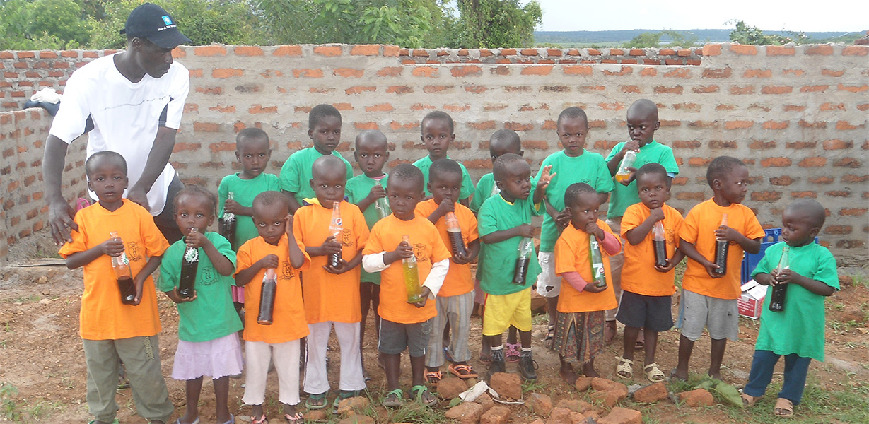 School children with drinks. The Soma Leo Foundation
